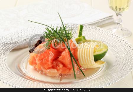 Salmon Gravlax stock photo, Gravlax (cured salmon) with lime, dill and butter by Digifoodstock