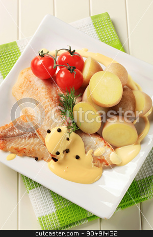 White fish fillets with potatoes and Hollandaise sauce stock photo, White fish fillets with new potatoes and Hollandaise sauce by Digifoodstock
