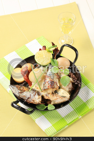 Pan fried mackerel with cream sauce and new potatoes stock photo, Pan fried mackerel with cream sauce and new potatoes in a skillet by Digifoodstock