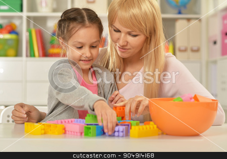little girl playing with mother stock photo, Portrait of a little girl playing with mother at home by Ruslan Huzau
