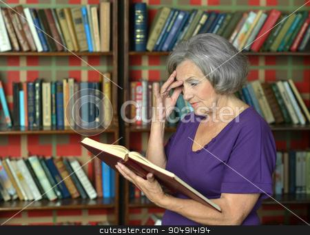 elderly woman with book stock photo, Portrait of a beautiful elderly woman with book by Ruslan Huzau