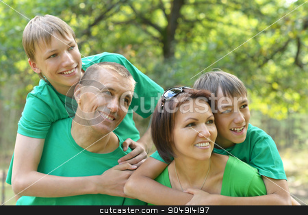 Family resting in  summer park stock photo, Happy Family resting in a summer park by Ruslan Huzau