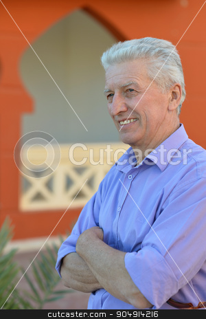 senior man   near hotel resort stock photo, happy senior man near hotel resort in summer by Ruslan Huzau