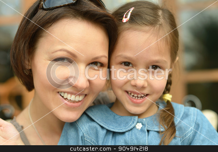 Little girl with  mother on  walk stock photo, Little cute girl with happy mother on a walk by Ruslan Huzau