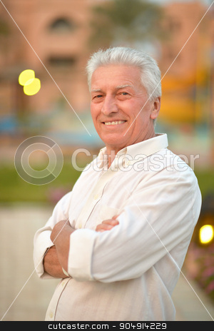 senior man  near hotel stock photo, Portrait of a senior man near hotel at tropic resort by Ruslan Huzau