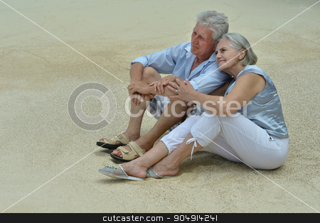 elderly couple rest at tropical beach stock photo, Happy elderly couple rest at tropical beach by Ruslan Huzau