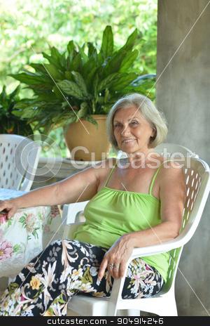 Older woman resting at tropical resort stock photo, Beautiful Older woman resting at tropical resort by Ruslan Huzau