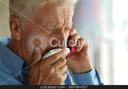 Sick old man calling doctor stock photo, Sick old man calling doctor at home by Ruslan Huzau