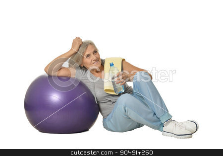 Senior womanr with water after exercising stock photo, Portrait Of  Senior woman sitting on a floor with water after exercising isolated on white by Ruslan Huzau