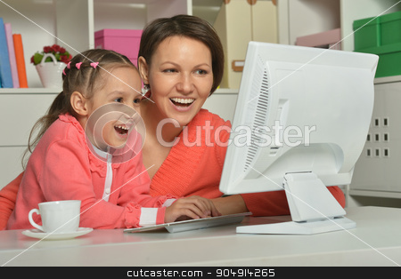 little girl  with mother and computer stock photo, Portrait of a little girl  with mother and computer at home by Ruslan Huzau