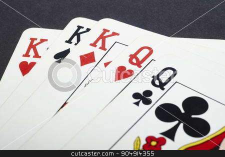 Poker card game with kings and queens full. Black background stock photo, Poker card game with kings and queens full. Black background. Horizontal by ABBPhoto
