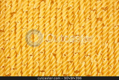Uncooked fusilli pasta  stock photo, Italian yellow short uncooked fusilli pasta closeup sorted vertically for background or texture. by Maryna Zaborina