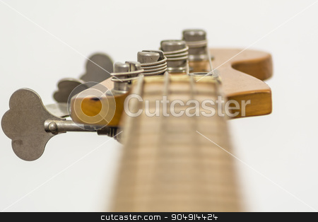 Electric bass head stock photo, close up of the head of an electric four sting bass by rarrarorro