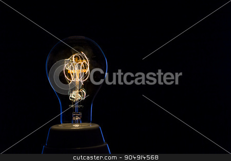 old electric lamp stock photo, Old electric bulb on black background by Fernando