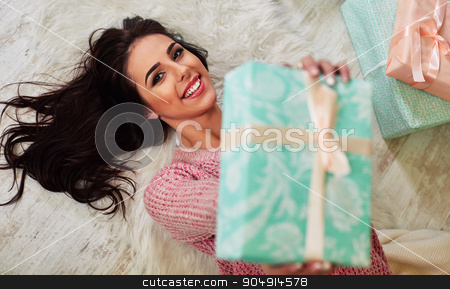 Closeup portrait of happy young Caucasian brunette woman opening Christmas gift box smiling  stock photo, Closeup portrait of happy young Caucasian brunette woman opening Christmas gift box  smiling  by mykhalets
