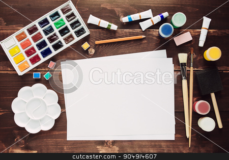 Paint background with blank paper sheet stock photo, Set of painting equipment with empty paper sheet on wooden table by sunapple