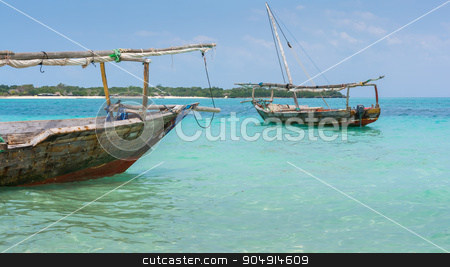Two Dhow boats  stock photo, Anchored wooden dhow boats on the amazing turquoise water in the Indian ocean  Zanzibar, Tanzania. by Robertobinetti70