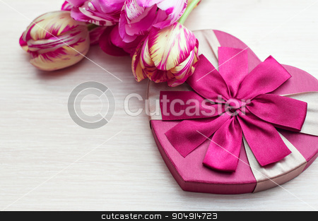 Heart shaped Valentines Day gift box with tulips and place for text stock photo, Heart shaped Valentines Day gift box with tulips and place for text. by timonko