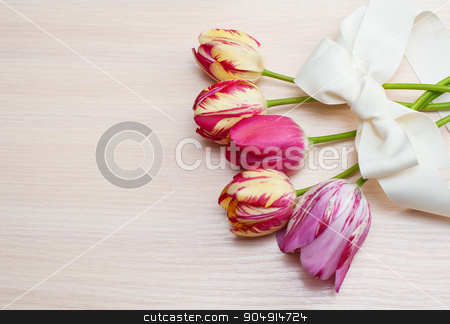 Bouquet of red tulips on white background with space for text stock photo, Bouquet of red tulips on white background with space for text. Valentine's composition by timonko
