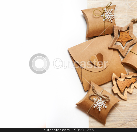 handmade wooden toys and Christmas boxes for gifts of kraft paper stock photo, handmade wooden toys and Christmas boxes for gifts of kraft paper. by timonko