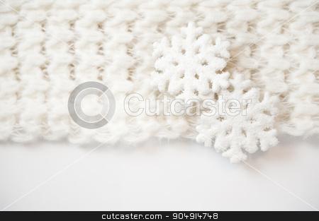 toy white snowflakes on a knit scarf stock photo, toy white snowflakes on a knit scarf. by timonko