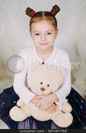 Cute little girl with Teddy bear stock photo, Beautiful chestnut head girl at the Christmas background by sunapple