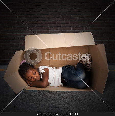 Poor child stock photo, Poor little girl sleeps in a cardboard by Federico Caputo