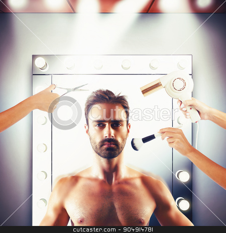 Model at beauty salon stock photo, Make-up and hairstyling for a man model by Federico Caputo
