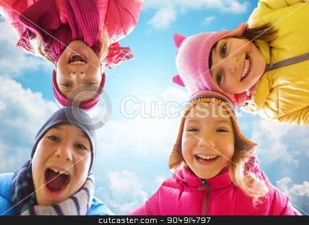 happy little children faces over blue sky stock photo, childhood, leisure, friendship and people concept - happy little children faces outdoors over blue sky and clouds background by Syda Productions