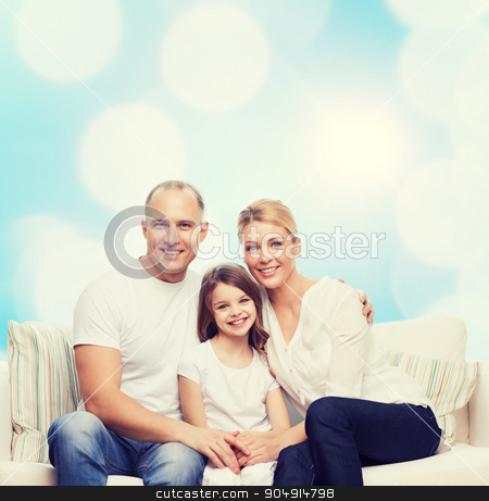 happy family at home stock photo, family, childhood, holidays and people concept - smiling mother, father and little girl over blue lights background by Syda Productions