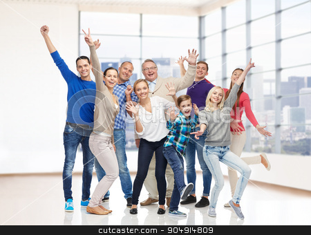 group of smiling people having fun stock photo, family, gender, generation and people concept - group of happy men, women and boy having fun and waving hands over empty office room or home by Syda Productions