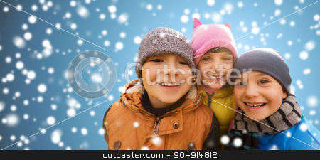 happy children hugging over snow background stock photo, childhood, christmas, winter, friendship and people concept - group of happy kids hugging over snow background by Syda Productions