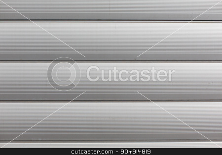 close up of aluminum metal garage door backdrop stock photo, background and texture - close up of aluminum metal garage door backdrop by Syda Productions