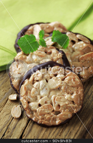 Nutty cookies stock photo, Nut Florentine cookies with a layer of chocolate on one side by Digifoodstock
