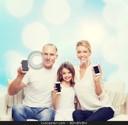 happy family with smartphones stock photo, holidays, technology, advertisement and people concept - smiling family with smartphones over blue lights background by Syda Productions