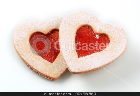 Heart shaped shortbread cookies  stock photo, Heart shaped shortbread cookies with jam filling by Digifoodstock