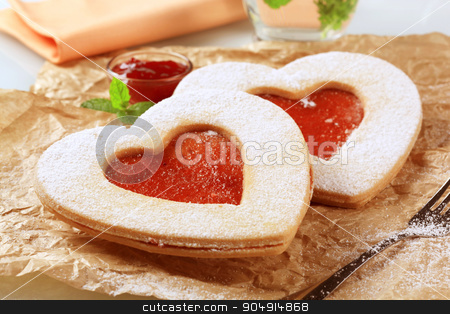 Heart shaped cookies  stock photo, Heart shaped shortbread cookies with jam filling by Digifoodstock