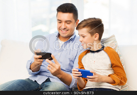 happy father and son with smartphones at home stock photo, leisure, technology, technology, family and people concept - happy father and son with smartphones texting message or playing game at home by Syda Productions
