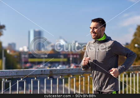happy young man running over city bridge stock photo, fitness, sport, people and lifestyle concept - happy young man running over city bridge by Syda Productions