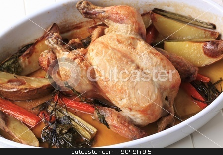 Oven-baked chicken and vegetables stock photo, Chicken with potatoes , carrot and celery baked in a casserole dish by Digifoodstock