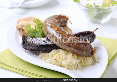 Blood sausage and white pudding with sauerkraut stock photo, Blood sausage and white pudding with sauerkraut and baked potato by Digifoodstock