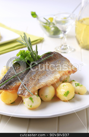 Pan-fried trout fillets with potatoes stock photo, Pan fried trout fillets with potatoes by Digifoodstock