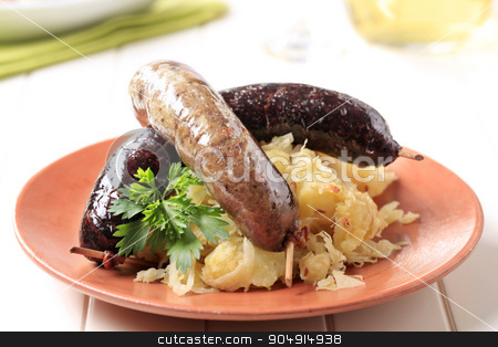 Blood sausage and white pudding  stock photo, Blood sausage and white pudding with sauerkraut and potatoes by Digifoodstock