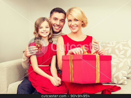 happy family opening gift box stock photo, family, christmas, x-mas, happiness and people concept - happy family opening by Syda Productions