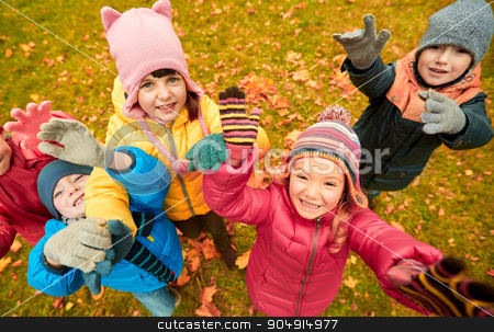 happy children waving hands in autumn park stock photo, childhood, leisure, friendship and people concept - group of happy children waving hands in autumn park from top by Syda Productions