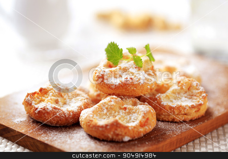 Mini sweet cheese pastries stock photo, Mini cheese pastries sprinkled with icing sugar by Digifoodstock