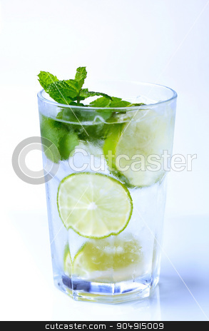 Iced drink stock photo, Glass of iced drink with lime and mint by Digifoodstock