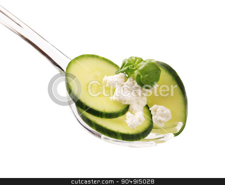 Cucumber and cheese stock photo, Slices of cucumber and cheese on a salad spoon by Digifoodstock
