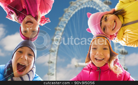 happy little children faces over ferry wheel stock photo, childhood, tourism, travel, vacation and people concept - happy little children faces outdoors over london ferry wheel background by Syda Productions