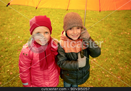 happy boy and girl with umbrella in autumn park stock photo, childhood, friendship, season, weather and people concept - happy little boy and girl with umbrella in autumn park by Syda Productions